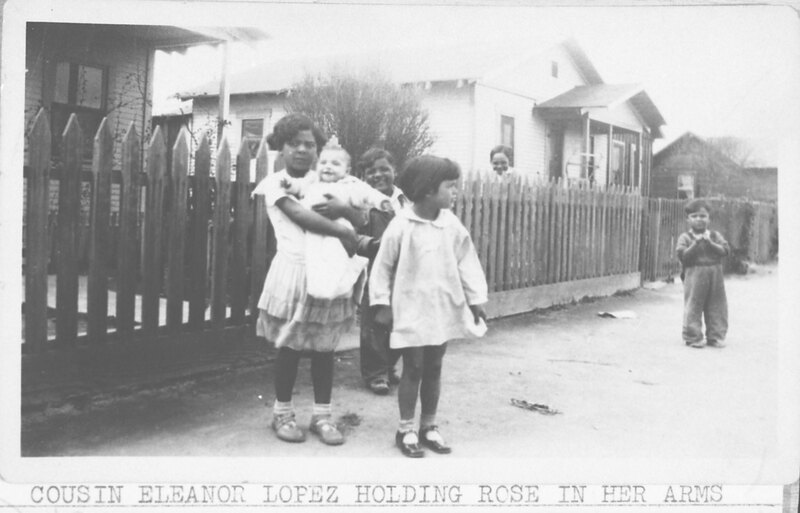 Group Photo of Children in Front of a La Colonia House