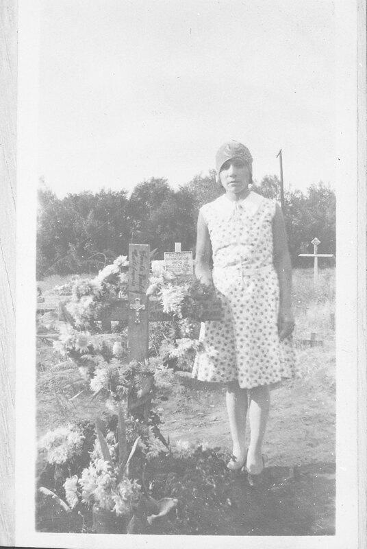 Guadalupe De La Rosa Standing By a Grave