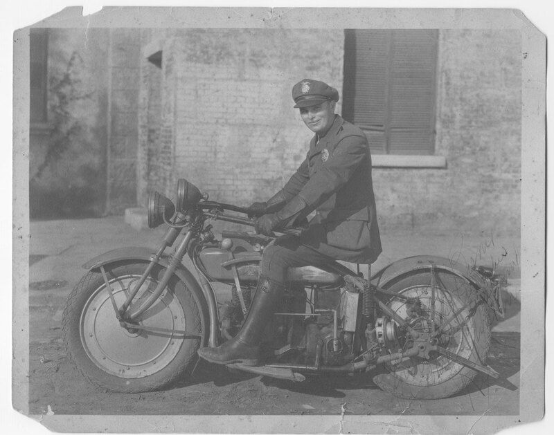 Police Officer Seated on Motorcycle, black and white