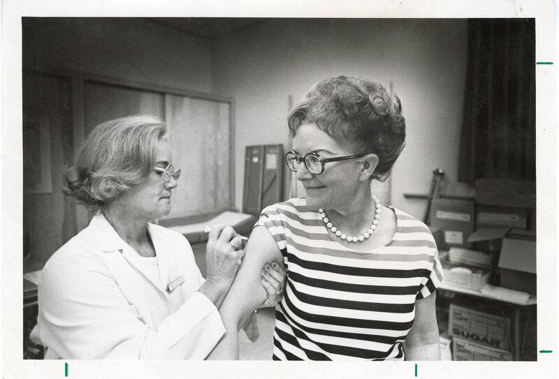 Nurse Administers Flu Vaccine