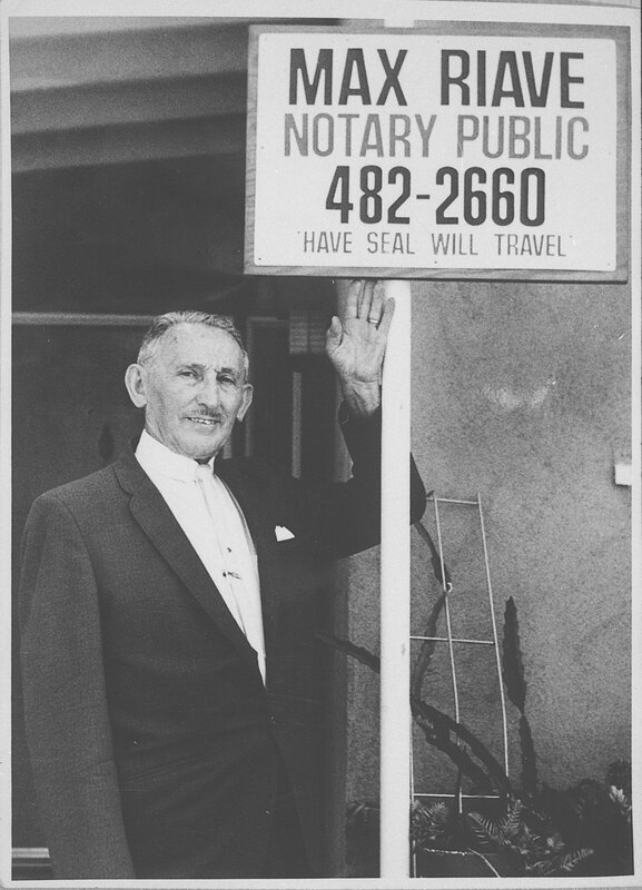 Max Riave Next to Notary Public Sign
