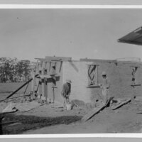 Two Workers, Adobe Construction