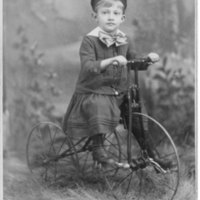 Boy on tricycle portrait