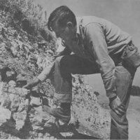 Man Checking Hillside for Oil