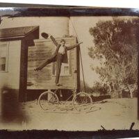 Man Balancing on Bicycle Seat