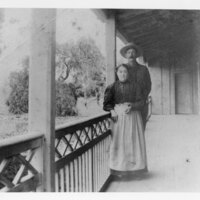 Mr. and Mrs. De La Riva on Porch at Adobe
