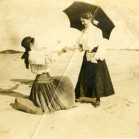 Two women on beach early 1900's