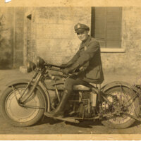 Police Officer Seated on Motorcycle, sepia