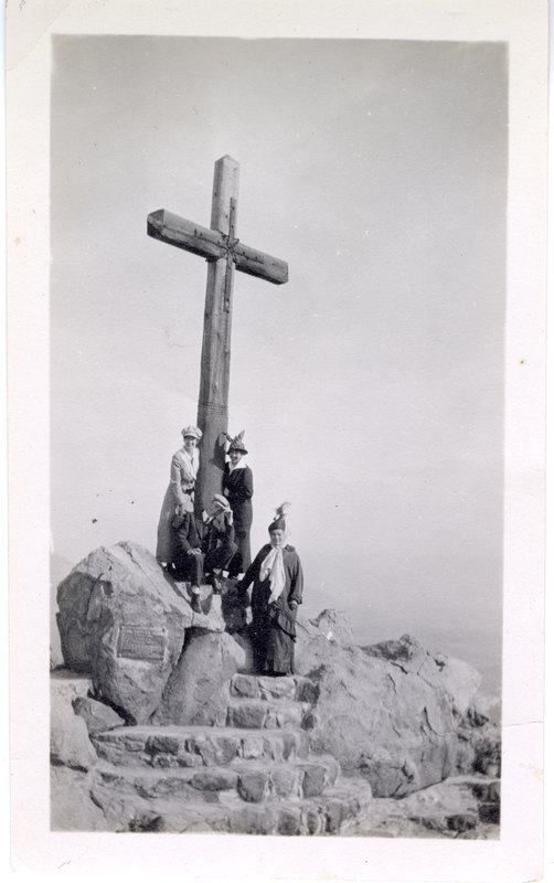 People at foot of wooden cross
