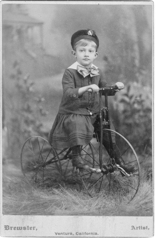 Boy on tricycle portrait