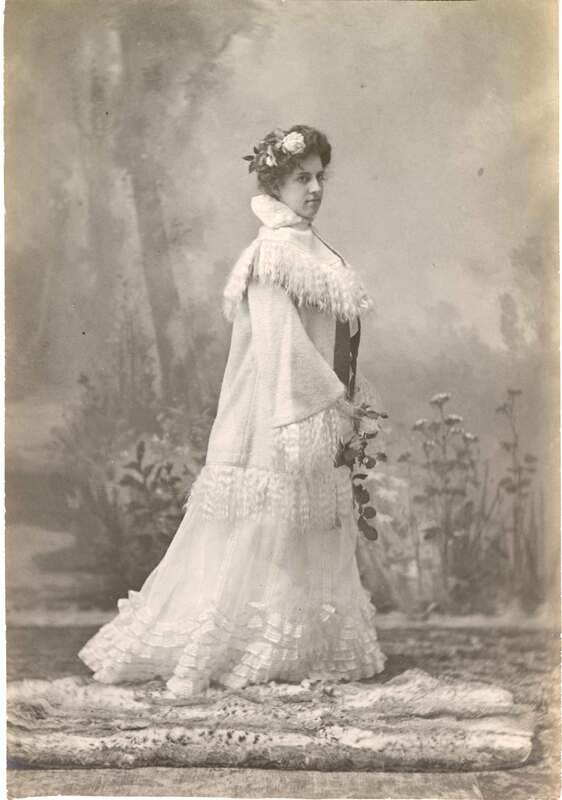 Pansy Brewster in Fancy Cloak With Flowers in Hair