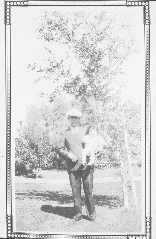 Juan Gonzalez De La Rosa Holding Son John as a Baby