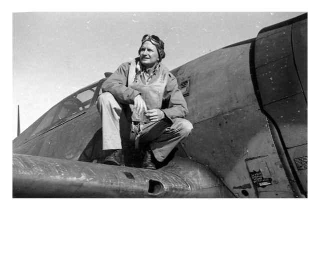 Lt. Edwin Pinkerton Perched on Plane Wing