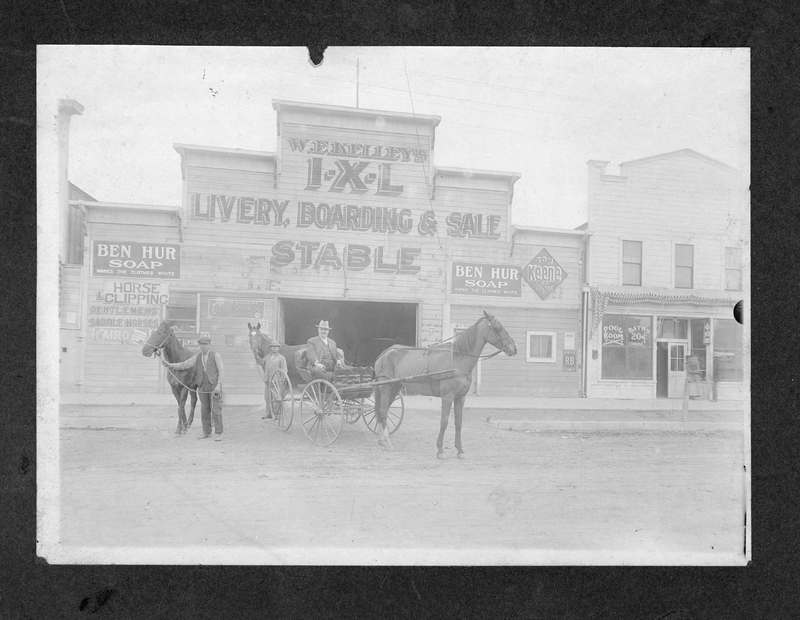 Men in front of livery stables