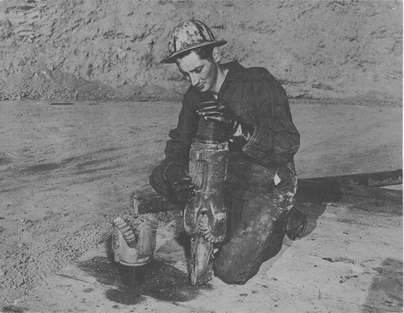 Man Holding Oil Drill Bit