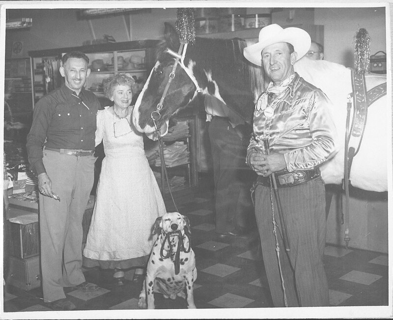 Max and Ruth Riave in their Store, Along With a Horse and Dog negative