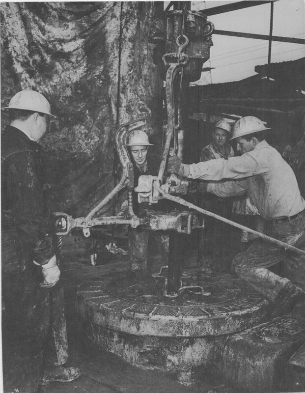 Men Working With Drill