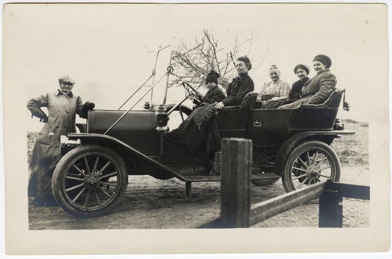 Women and a Boy in an Open Car