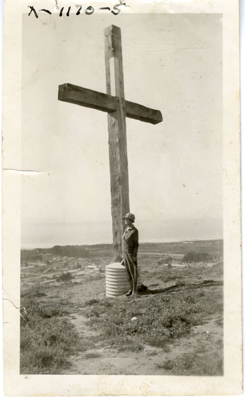 Woman Next to Hill Cross