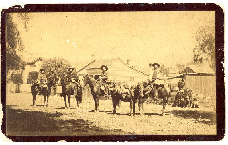 Four Men on Horseback