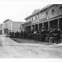 People on Bicycles in front of Santa Clara House in Ventura