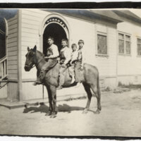 Four Boys on Horseback