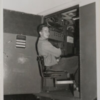 Young Man Seated at Schlumberger Logging Unit