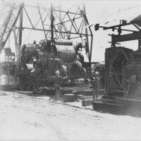 Men Installing Oil Drilling Equipment