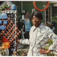 Portrait of Folk Artist Beatrice Wyatt Standing in Her Yard