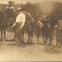 Men and Horses Carrying Deer