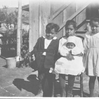 Portrait of Three Children and a Baby