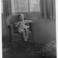 Boy holding wooden toy