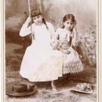 Two Girls on Swing Portrait