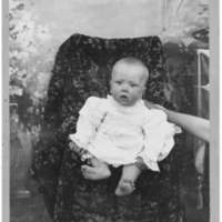 Seated portrait of unidentified infant