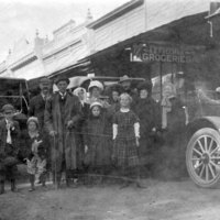 Families in Front of a Grocery Store