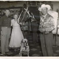 Max and Ruth Riave in their Store, Along With a Horse and Dog print