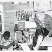Library Assistant and Children at West End Branch Library