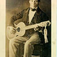 Jose De La Rosa with a Guitar