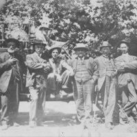 Group Photo of men in front of tractor